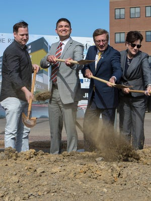 Jeff Lamont, CEO of Lamont Companies, Inc., (left) Daren Ketcham, director of community development, Mayor Mike Huether and Michelle Erpenbach, city councilor, Central District participate in a groundbreaking ceremony for the mixed-use parking ramp project on Monday, May 7, 2018 in downtown Sioux Falls, S.D.