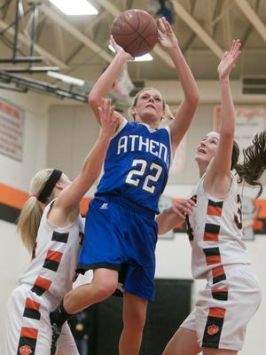 Athens' Briana Lavicka, center, shoots over Stratford's Brittany Bredemann, left, and Andie Zuelke, right, during Tuesday's game.