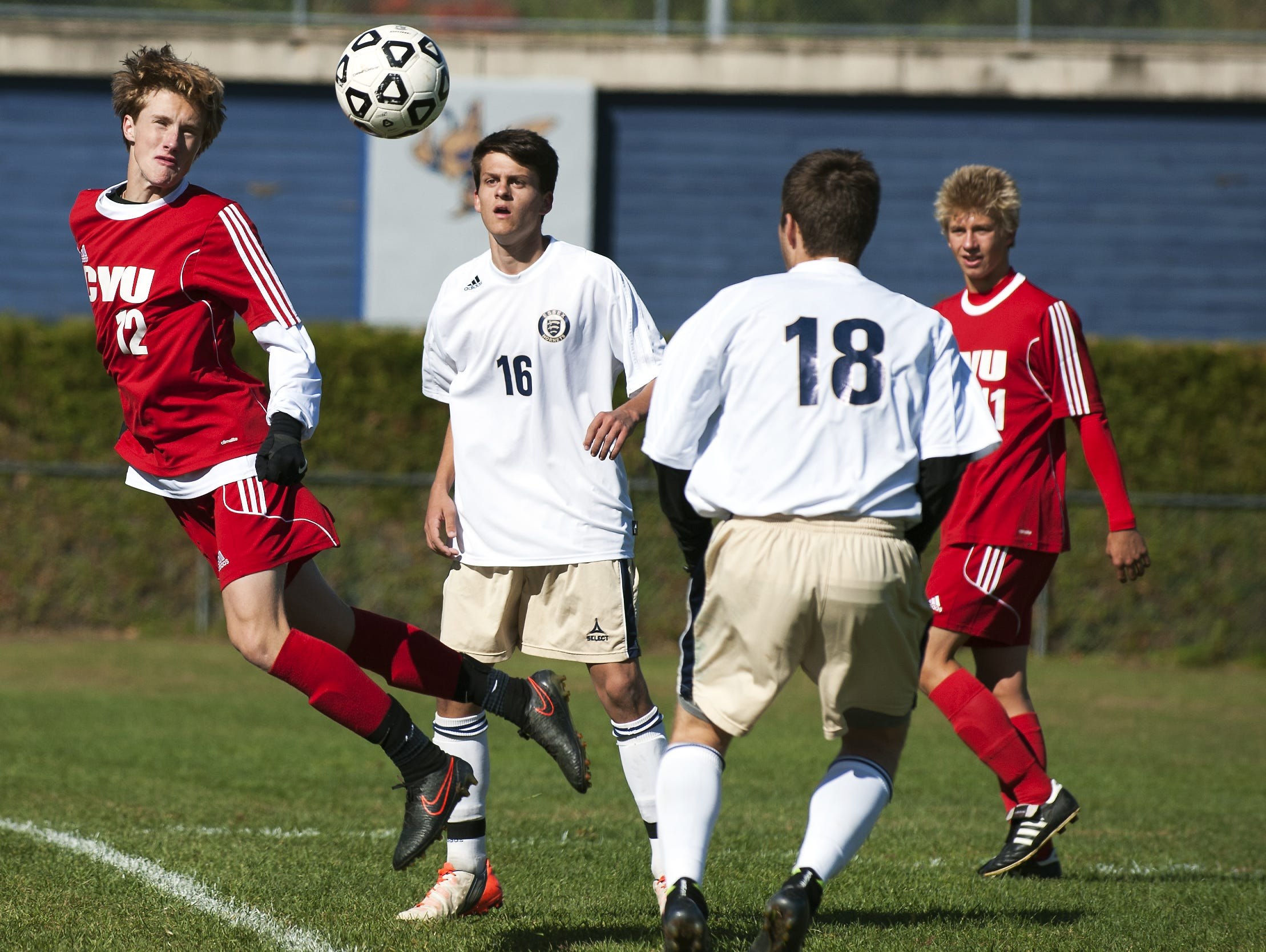 CVU's Joe Parento (12) heads the ball during a high school boys soccer game Saturday.