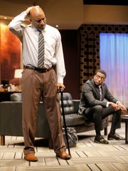 """Frank (left, Ezra Knight) and Lewis (Garrett Lee Hendricks) square off in """"Playing the Assassin"""" at the Delaware Theatre Company."""