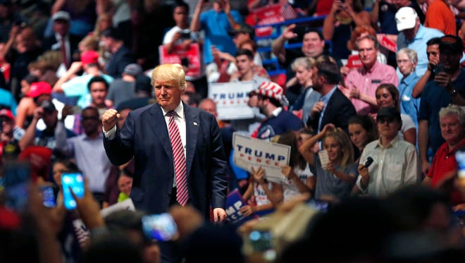 Republican presidential candidate Donald Trump responds to the crowd after speaking at a campaign rally Tuesday near Austin.