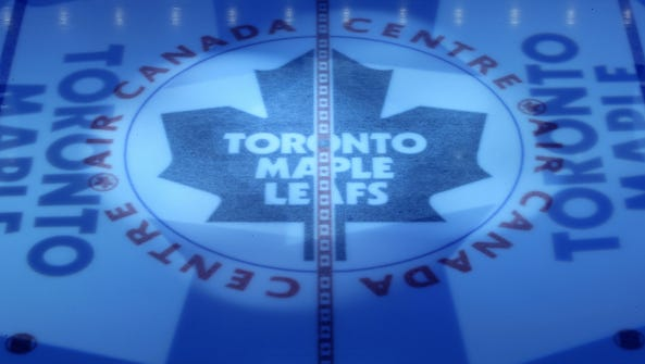 The Toronto Maple Leafs logo at center ice.