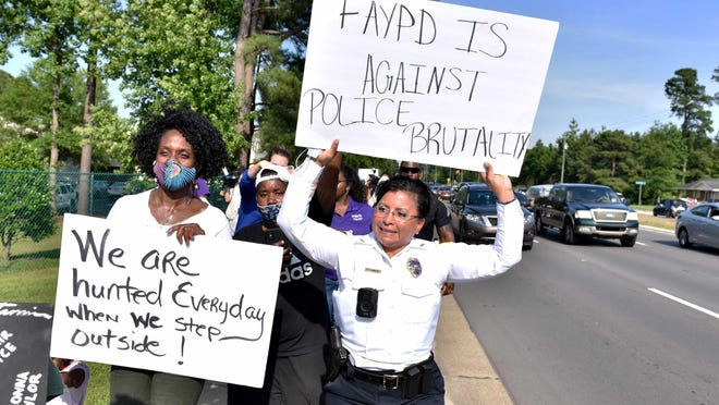 Fayetteville Police Chief Gina Hawkins takes part in a recent march along Cliffdale Road. She said her priority is hiring officers with integrity who handle calls well  and in a constitutional manner rather than focusing on their race.