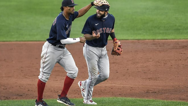 Xander Bogaerts and Jose Peraza (right) turned a game-changing double play in the second inning Tuesday.
