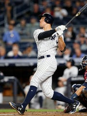 Yankees' Aaron Judge watches his solo home run during