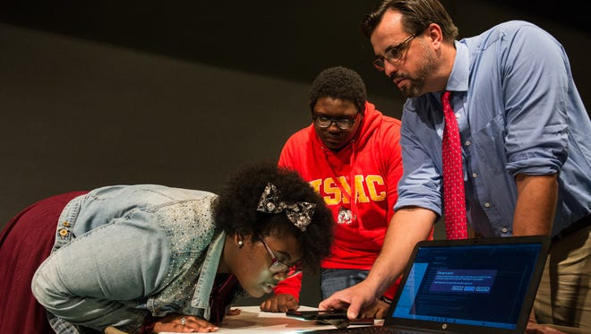 Snow Hill Middle School Science teacher Everett Evansky demonstrates the operation of an xChip while eighth-graders MiAsia Timmons and Bryce Purnell observe on Tuesday, Oct 17, 2017.