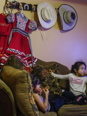 "Miriam Nunez's family is immersed in American culture but still carries on traditions from their Mexican heritage. Nunez is one of a few thousand Kansan's, mostly Hispanics, who were brought to the U.S. as young children and who in 2012 applied for a special status called Deferred Action for Childhood Arrivals, along with another 750,000 across the country. President Donald Trump has so far not indicated what he intends to do regarding these so-called ""dreamers."" (Oliver Morrison/The Wichita Eagle via AP)"