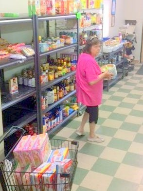 Keeping the shelves stocked at the Lincoln County Food Bank is one of the major volunteer jobs.