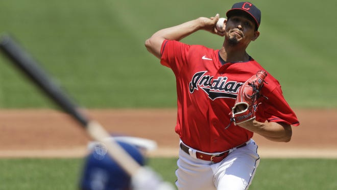 Indians starting pitcher Carlos Carrasco delivers to Kansas City Royals' Whit Merrifield in the first inning Sunday in Cleveland.