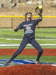Morris Catholic shortstop Stephanie Smith catches the