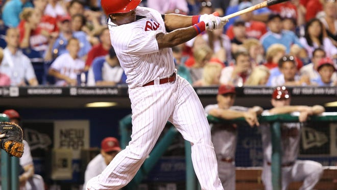 Philadelphia Phillies right fielder Marlon Byrd (3) hits a double during the seventh inning of a game against the Arizona Diamondbacks at Citizens Bank Park. The Phillies won 9-5. Credit: Bill Streicher-USA TODAY Sports