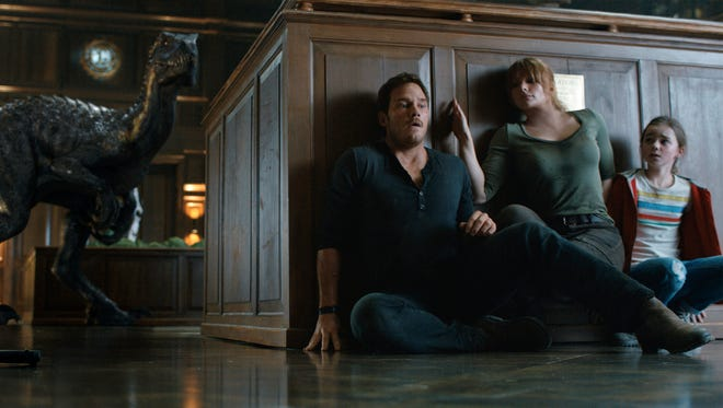 "This image released by Universal Pictures shows, from left, Chris Pratt, Bryce Dallas Howard and Isabella Sermon in a scene from the upcoming ""Jurassic World: Fallen Kingdom."" (Universal Pictures via AP)"