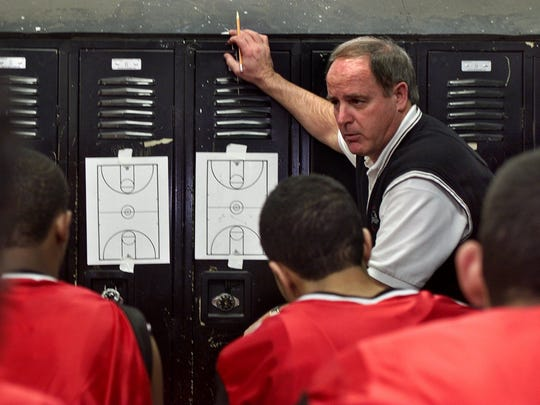 Neptune head basketball coach Ken O'Donnell goes of