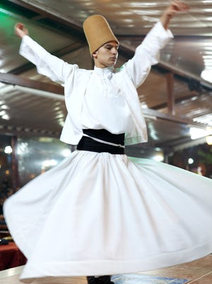 In Turkey, a dervish spins in a prayerful trance, meditating on the divine power of love, the greatness of God, and freedom from worldly desires.