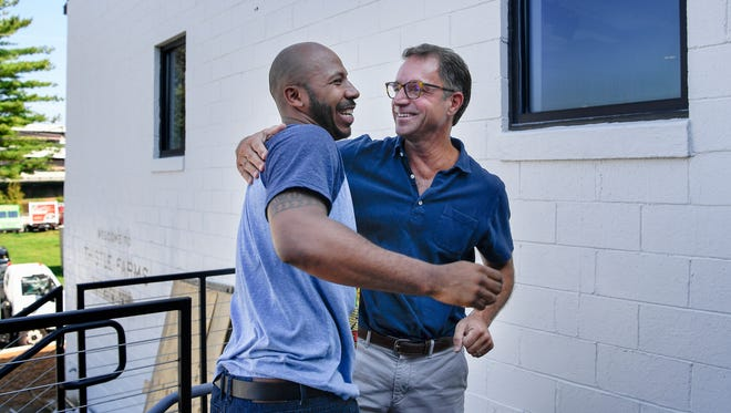 Donald Reed, left, greets Hal Cato, whom he calls Pops, after arriving at the new Cafe at Thistle Farms in Nashville on Friday, Sept. 22, 2017.