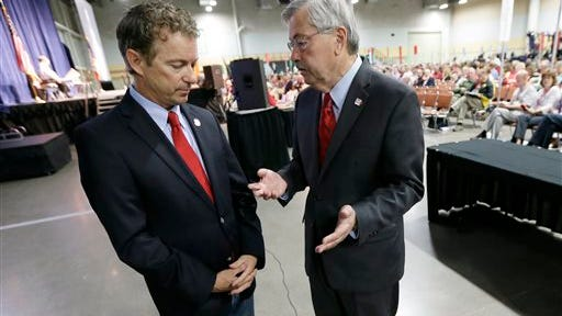 In this June 14, 2014, file photo, Iowa Gov. Terry Branstad, right, talks with U.S. Sen. Rand Paul, R-Ky., during the GOP state convention in Des Moines.