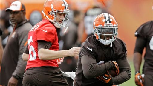 Ben Tate takes a handoff from Brian Hoyer here, but will likely get the ball from Johnny Manziel when the season starts.