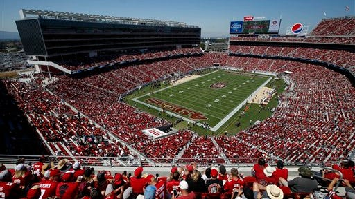 Fans watch as the San Francisco 49ers play the Denver Broncos during the first quarter of an NFL preseason football game at Levi's Stadium in Santa Clara, Calif., Sunday, Aug. 17, 2014. (AP Photo/Tony Avelar)