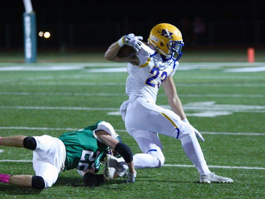 Waynesboro's Cameron Keck (23) breaks a tackle from