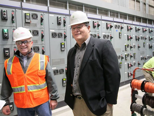 Potawatomi Attorney General Jeff Crawford (right) toured the Tribe's waste-to-energy facility with Charles Opferman when it opened in 2013.