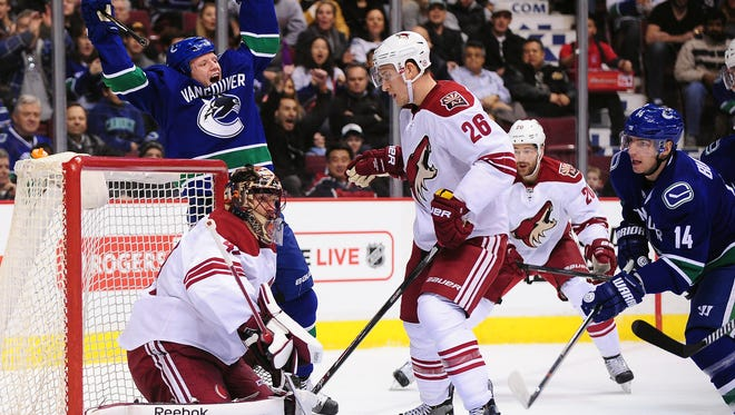 Vancouver Canucks forward Derek Dorsett (51) celebrates a goal against Arizona Coyotes goaltender Mike Smith (41) during the first period at Rogers Arena in Vancouver, British Columbia on Dec. 22.