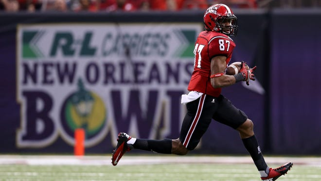 Louisiana-Lafayette Ragin' Cajuns wide receiver Darryl Surgent makes a catch against the Tulane Green Wave during the second quarter.