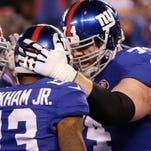 New York Giants guard Geoff Schwartz (74) congratulates New York Giants wide receiver Odell Beckham Jr. in a 2014 game.