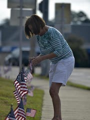 A local resident honors Staff Sgt. Forrest Sibley by