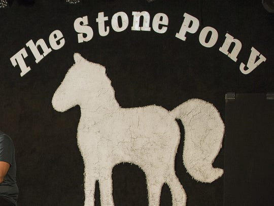 The backdrop of the stage at The Stone Pony in Asbury