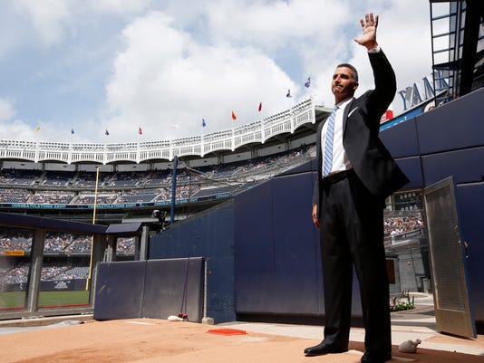 Retired New York Yankees pitcher Andy Pettitte waves to the crowd from the bullpen as he is introduced in Yankee Stadium's Monument Park during a pregame ceremony retiring his number before a baseball game in New York, Sunday, Aug. 23, 2015.  The Yankees will retire Pettitte's No. 46 Sunday and place a plaque in Monument park honoring the lefty pitcher. (AP Photo/Kathy Willens, Pool)