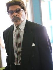 Landlord Will Sherard enters municipal court in Milwaukee.
