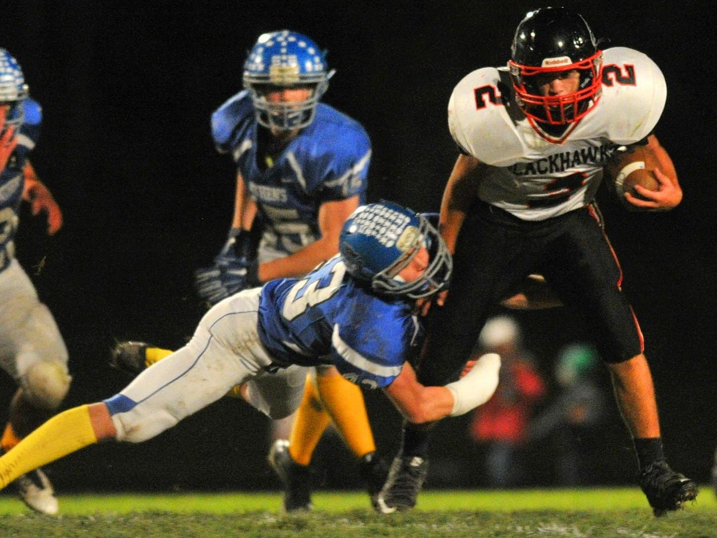 Owen-Withee's Kevin Kitlica(2), right, attempts to shake off Athens' Klay Ellenbecker(43) during Friday night's Cloverwood Conference boys football matchup at Athens High School football field.