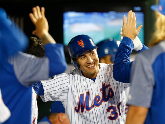 Jun 2, 2018; New York City, NY, USA;  New York Mets left fielder Michael Conforto (30) celebrates after hitting a home run in the sixth inning against the Chicago Cubs at Citi Field.