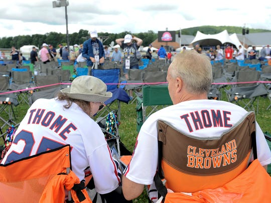 Jim Thome fans Betsy Yolchim, left, and her husband Tomm Betsy, of Erie, Pa., wait for the start of National Baseball Hall of Fame induction ceremonies Sunday, July 29, 2018, in Cooperstown, N.Y. (AP Photo/Hans Pennink)