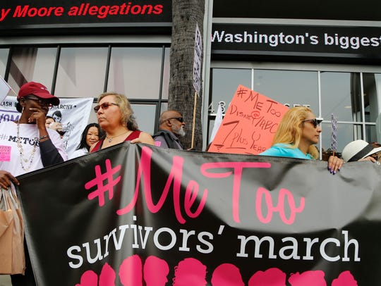 In this Nov. 12, 2017, file photo, participants rally outside CNN's Hollywood studios on Sunset Boulevard to take a stand against sexual assault and harassment for the #MeToo March in the Hollywood district of Los Angeles.