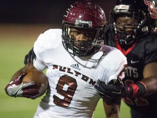 Fulton's Dorian Williamson is grabbed on a run by Central's