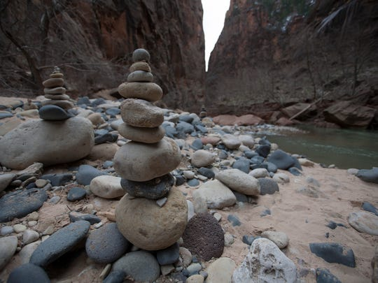 Rock cairns at the mouth of the Narrows on the Virgin River in Zion National Park.