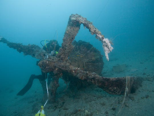 Jon Hazelbaker of Fort Myers Beach inspects one of the propellers of a B-26 Marauder that crashed Nov. 16, 1942, 30 miles southwest of the Sanibel Lighthouse.