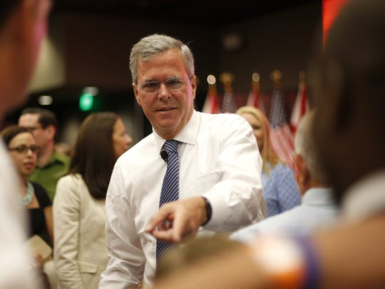Former Gov. Jeb Bush greets supporters during a visit to Tallahassee last year.