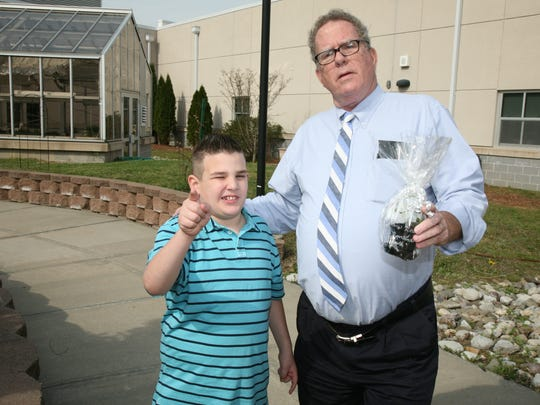 Sayreville Mayor O'Brien with CLL student  Ryan Walsh who presented him a plant grown in the school's greenhouse to celebrate Earth Day.