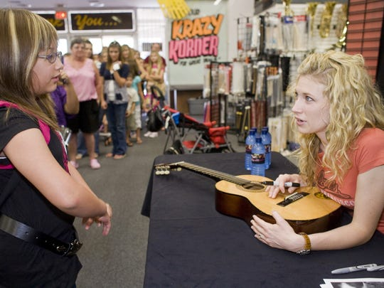 In 2008, Brooke White visited Milano Music Center in Mesa to meet fans and sign autographs.