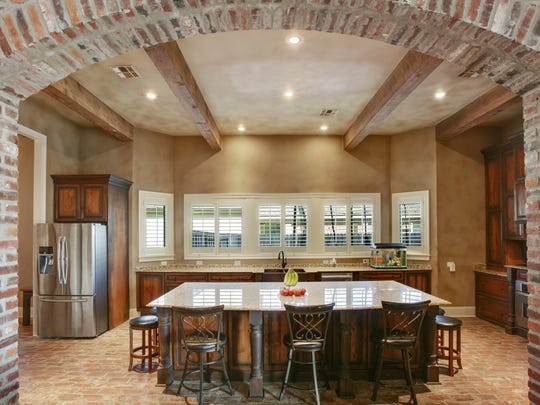 The gourmet kitchen has lots of eating and gathering space.
