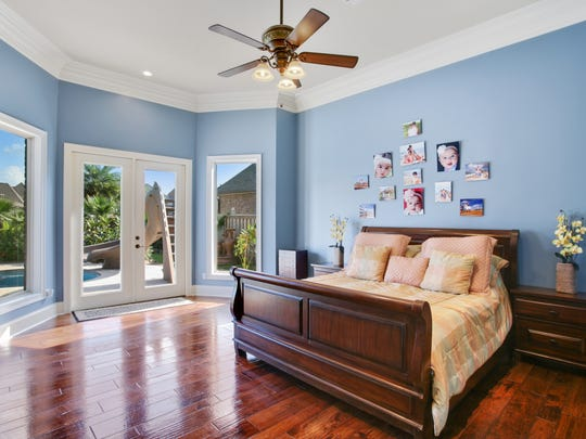 The bedrooms feature gorgeous wood floors and lots of natural light.
