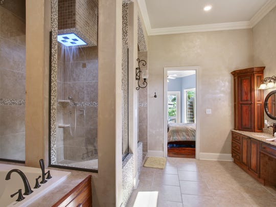 The spa-like master bath has designer touches throughout.
