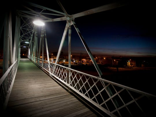 The metal beams of the 108-year-old Jefferson Avenue Footbridge contrasts the winter sky. A favorite Springfield landmark, the footbridge is picturesque reminder of the lifestyle of the city of 1902.