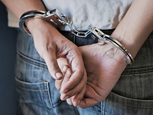 636135976126068397-stock-handcuffs.jpg
