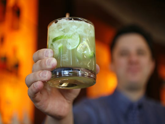 """Toast Brazilian IndyCar drivers with a caipirinha, the country's """"national drink,"""" at Downtown Indianapolis' Fogo De Chao. Tony Kanaan celebrated his 2013 Indy 500 win at the restaurant."""