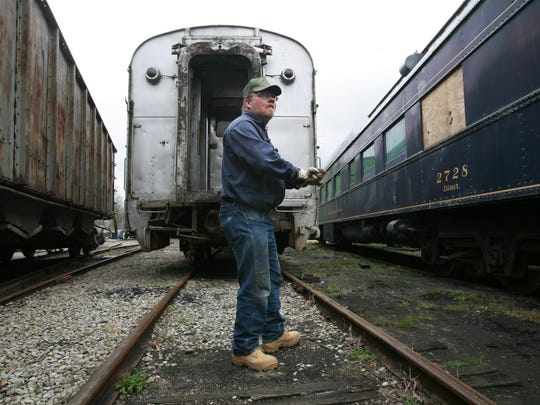 Volunteer Engineer Conductor Jay Harmon helps to couple an engine to the dining car at the Indiana Transportation Museum . Volunteers at the Indiana Transportation Museum clean and work to get the trains in shape for the upcoming season. 4/19/09 (Michelle Pemberton/The Indianapolis Star) <b>04/23/2009 - L04 - NOBLESVILLE - 1ST - THE INDIANAPOLIS STAR</b><br />Volunteer Jay Harmon helps to couple an engine to the dining car at the Indiana Transportation Museum at Forest Park in Noblesville.