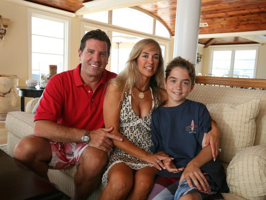 Eric Bolling pictured with his wife and son at their Jersey Shore beach home in 2009.