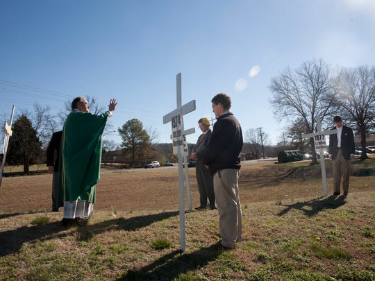 """In 2013, Father Mike Johnston led a memorial service for """"lives lost to abortion"""" at St. Henry Parish"""